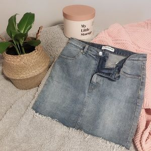 90s Mid-Waist Distressed Denim Skirt | Medium Wash